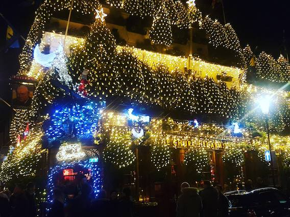 Churchill arms pub London with Christmas decoration on